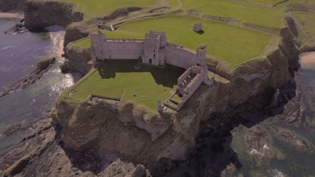 Aerial views of Seacliff beach and Tantallon Castle, North Berwick, Scotland.